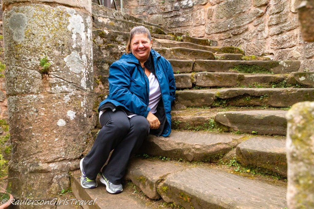 Heather sitting on the castle steps