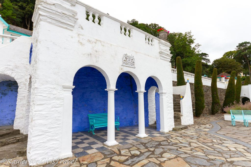 Blue bench under white arches at Portmeirion Hotel