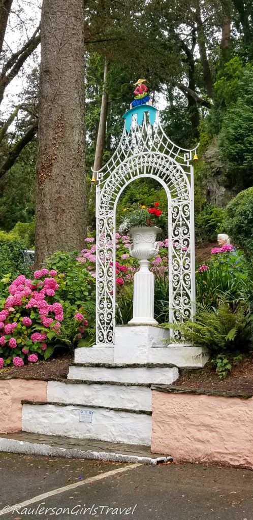 Asian statue on flower stand in Portmeirion