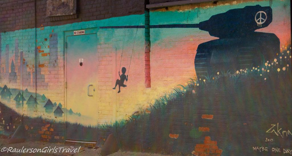 2015 Murals in the Market - kid swinging on a tank