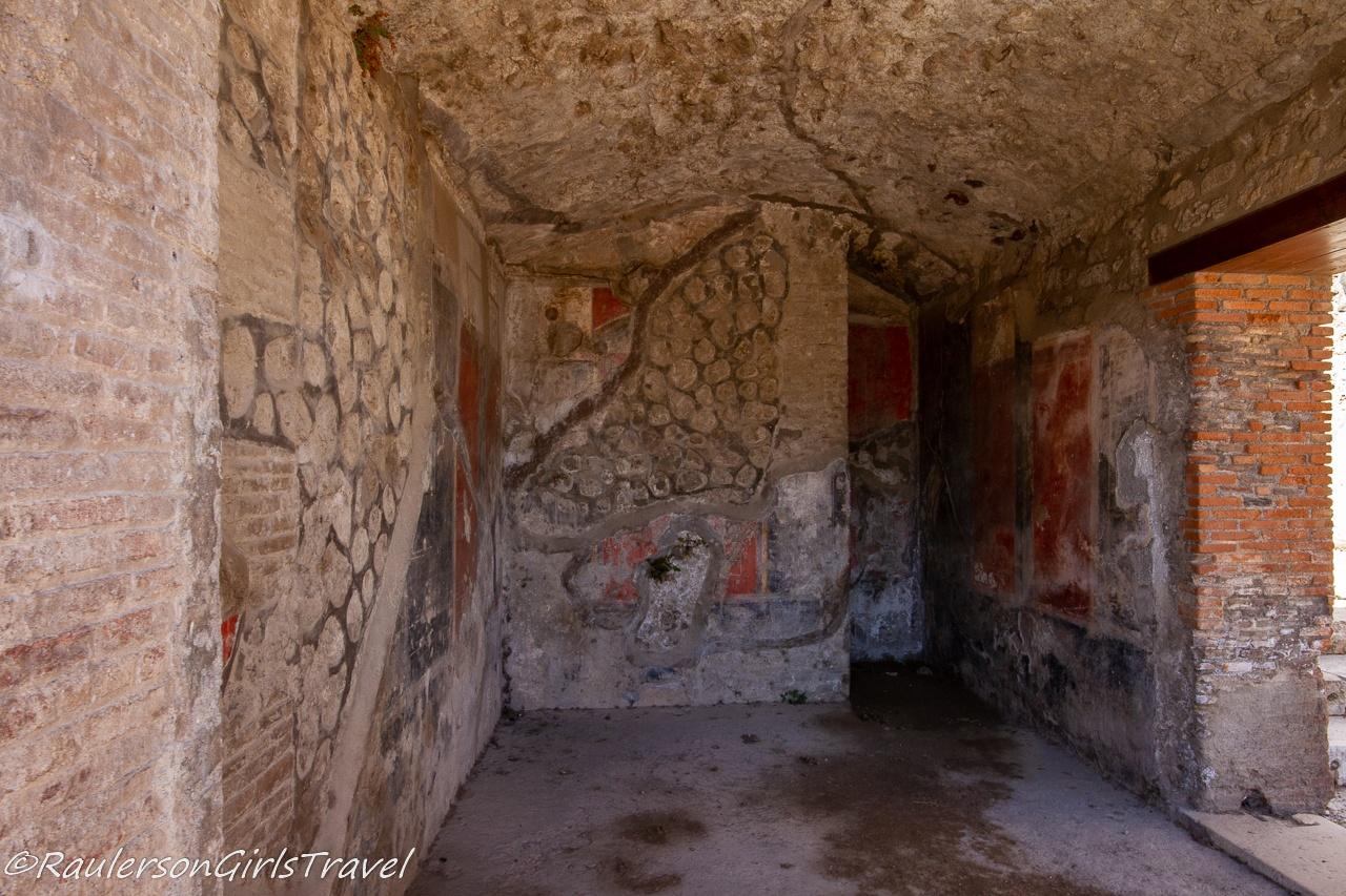 Artwork ruins on walls in Pompeii