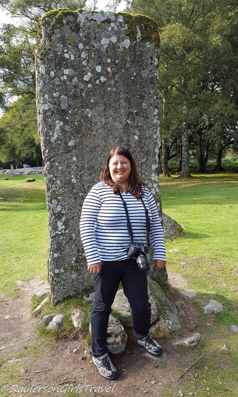 Heather next to standing stones - Celebrating Birthday Abroad