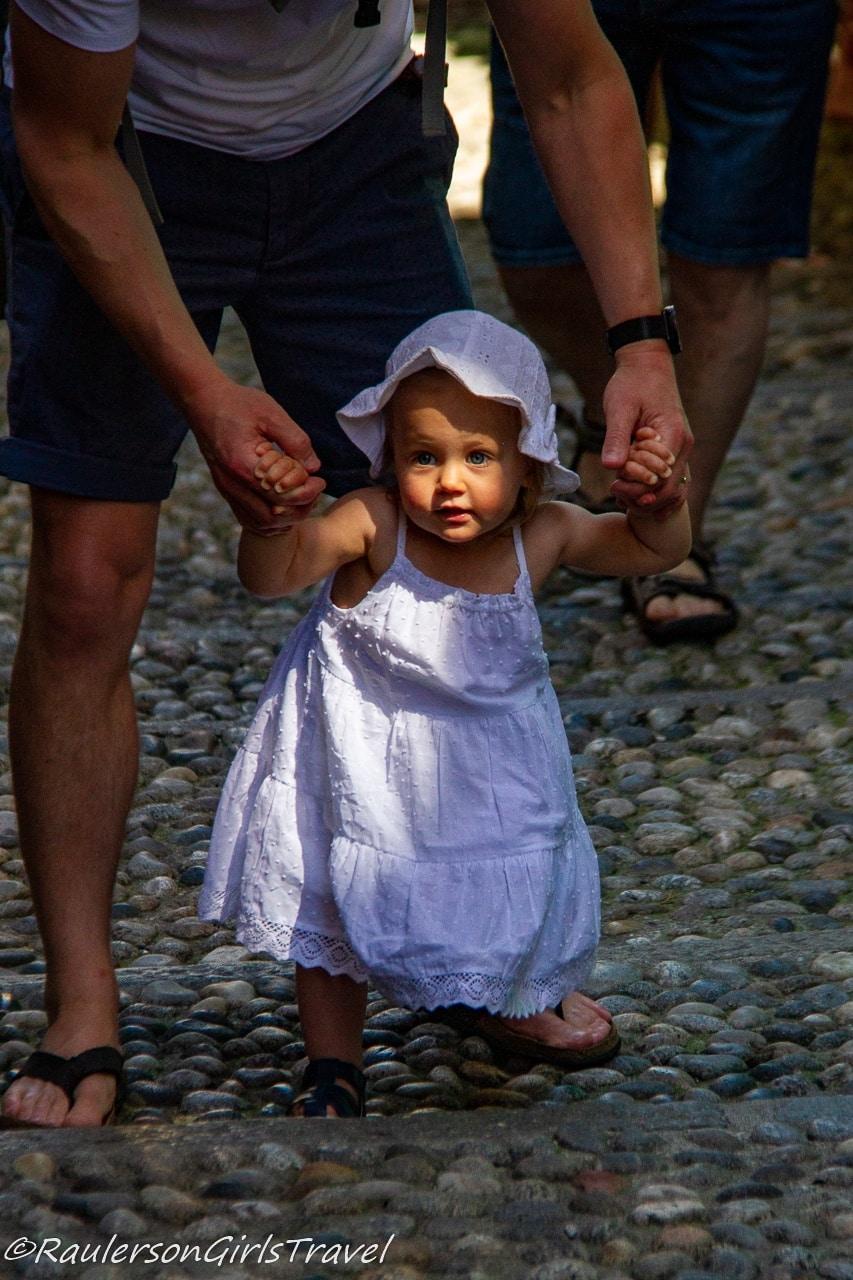 Little Girl walking on the steps in Bellagio