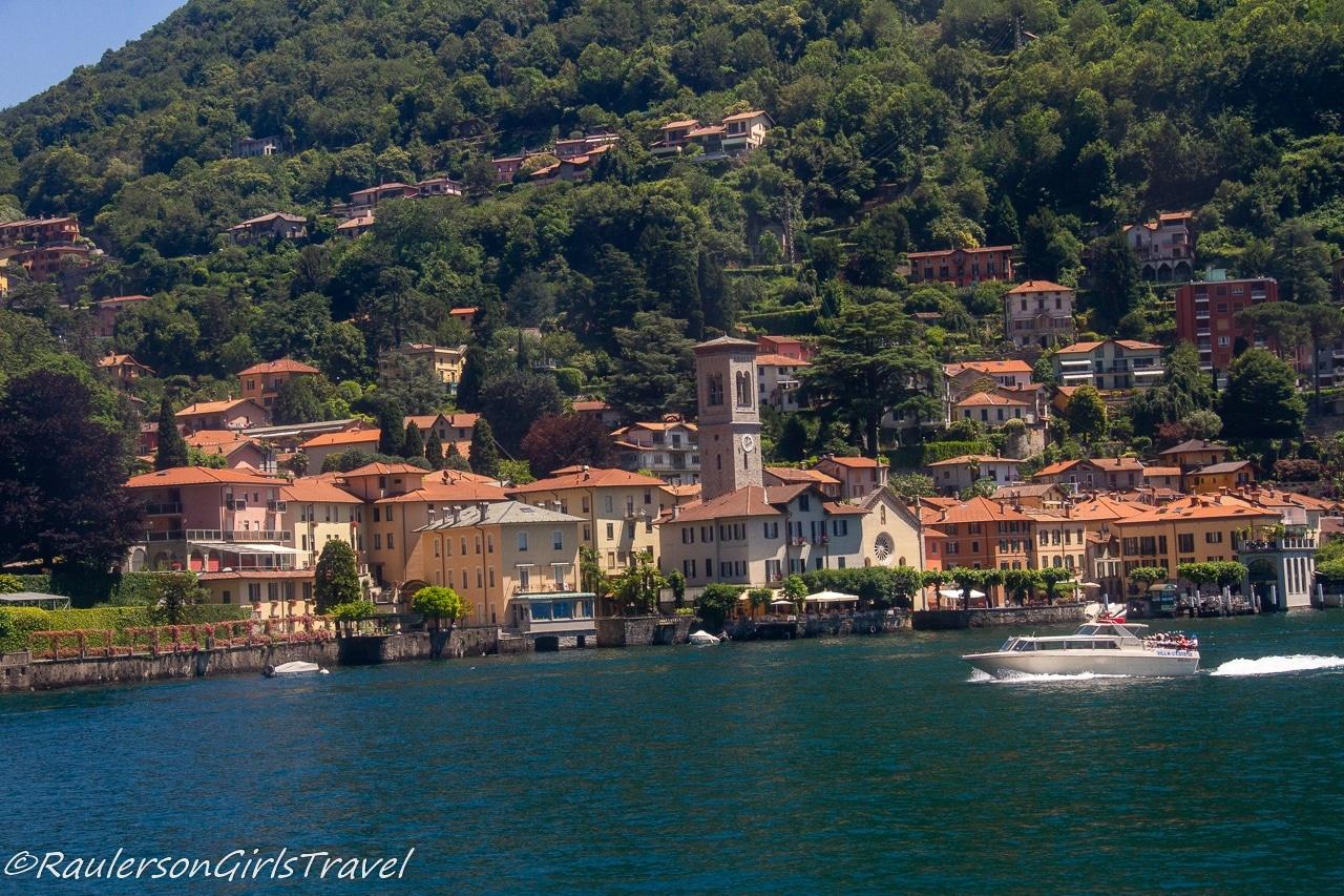 Boat speeding past Argegno on Lake Como