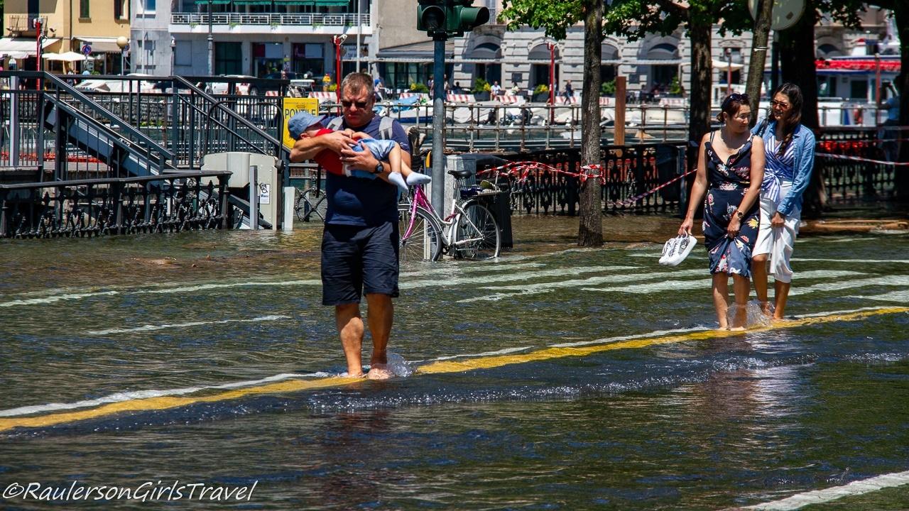 Walking through the Flooded Street of Como