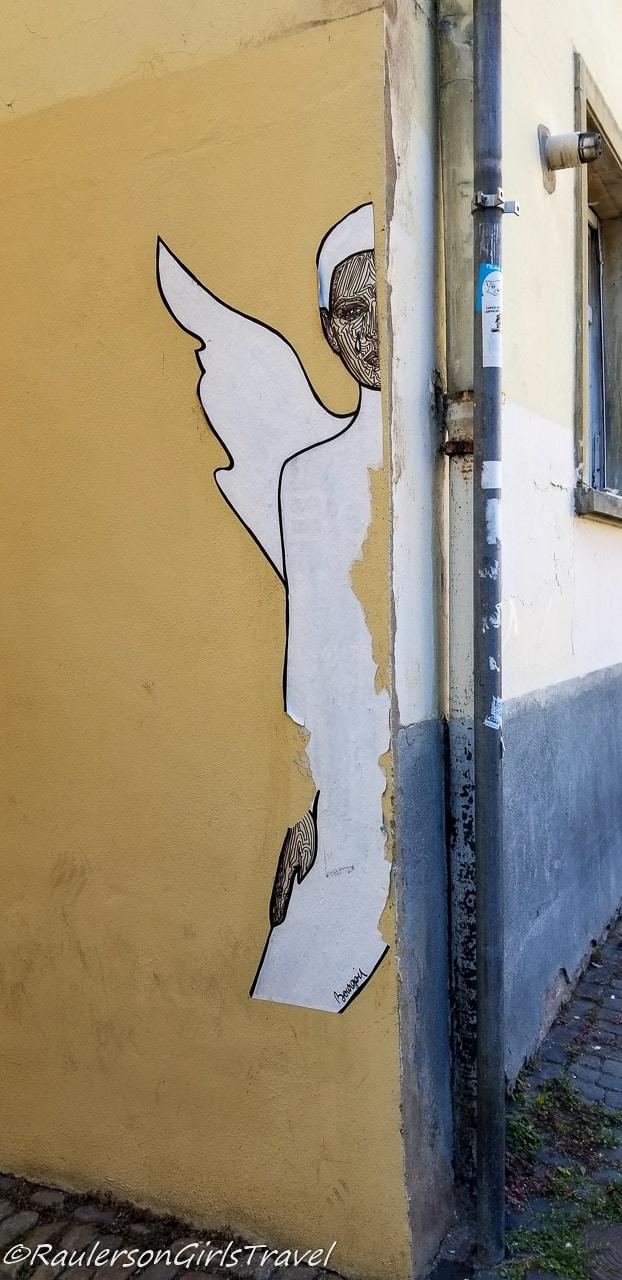 Hiding angel street art in Strasbourg