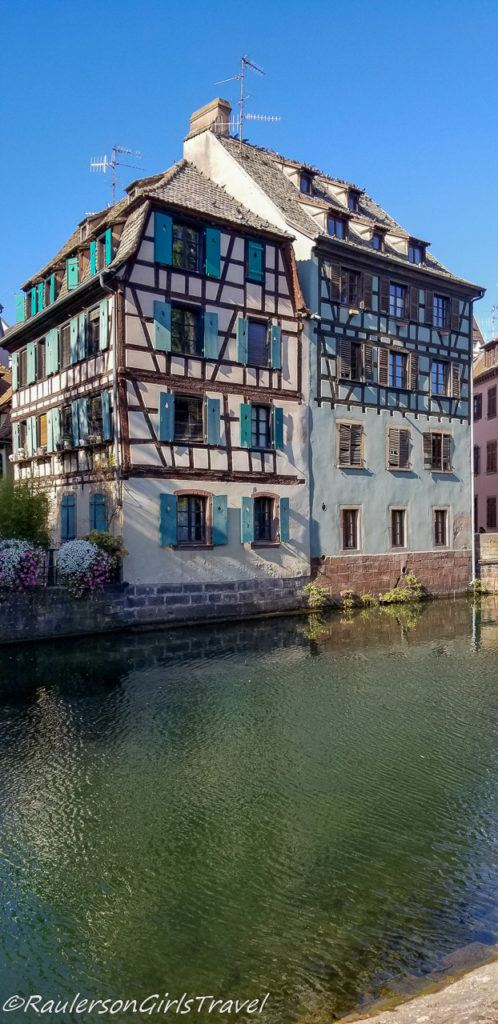 Timber-framed buildings with teal shutters in Strasbourg