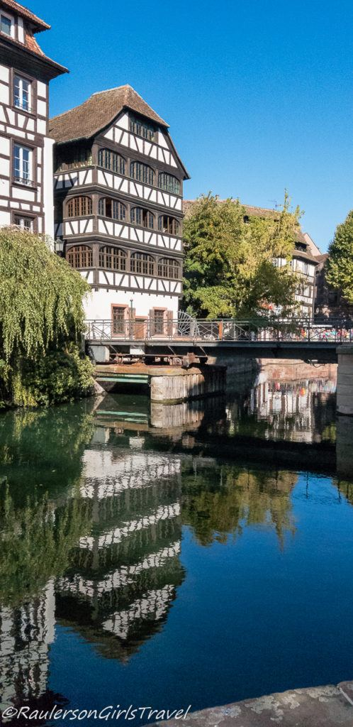 Reflection of timber-framed house in the Strasbourg Canal