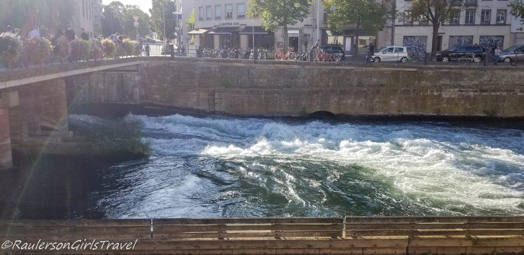 Water flowing through the locks in the canal in Strasbourg