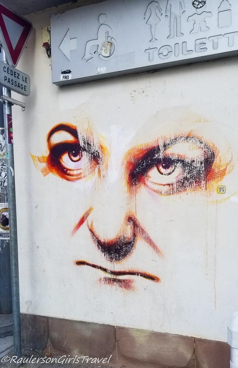 Serious face street art