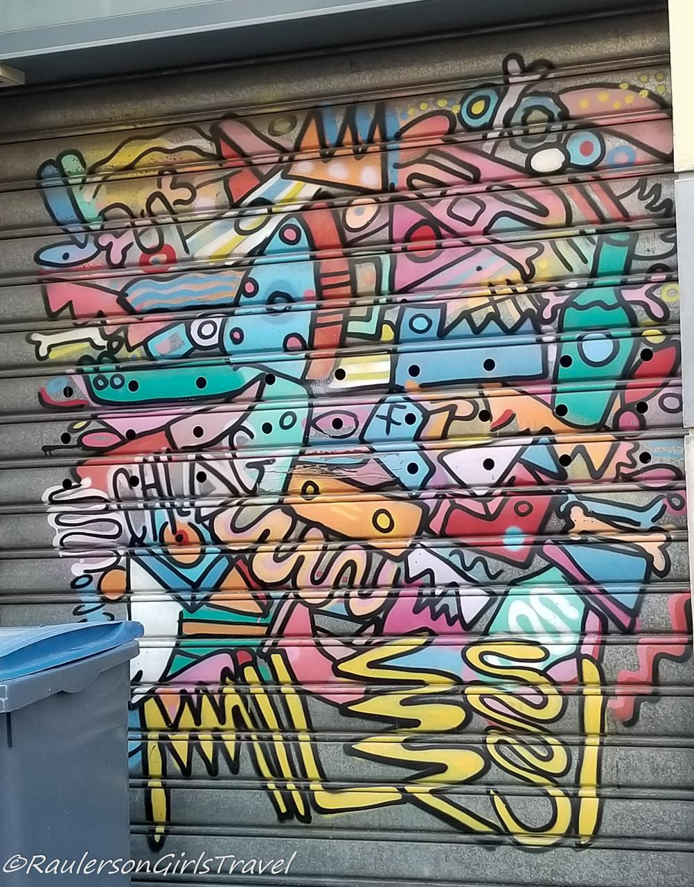 Colorful collage on a garage door