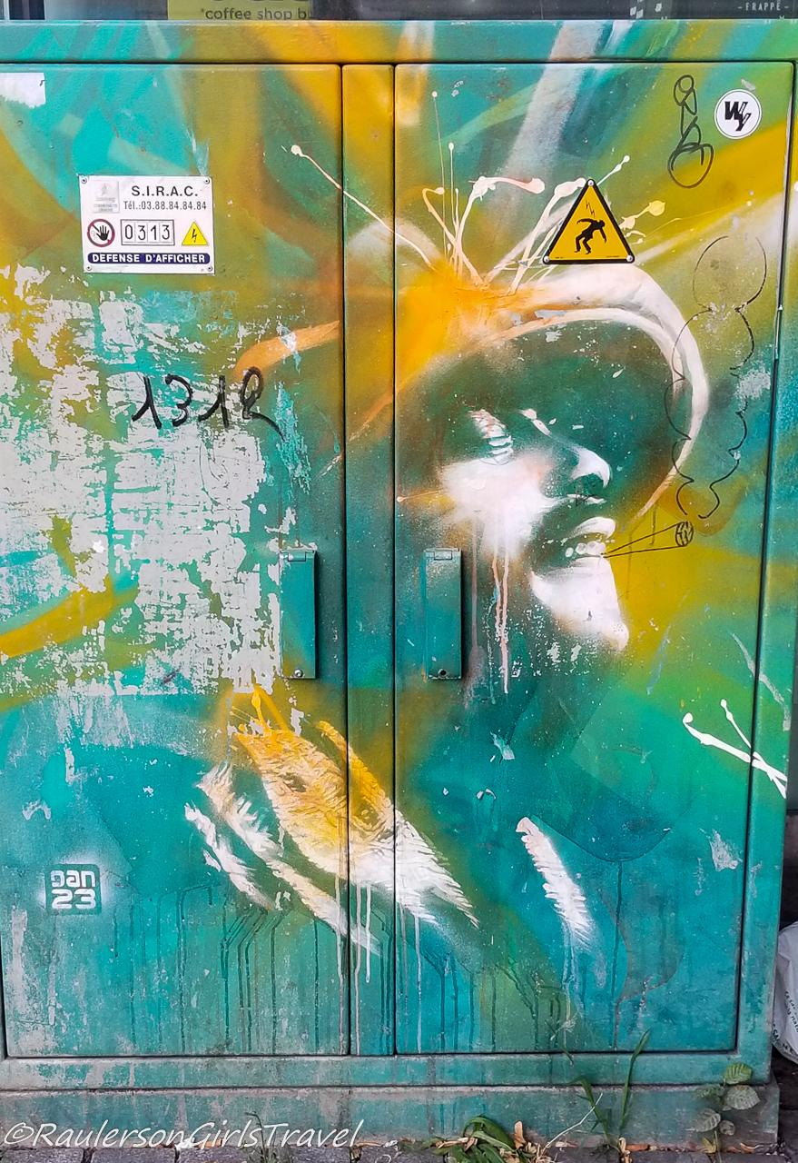 Mans Face on Yellow and Blue background - Street Art in Strasbourg
