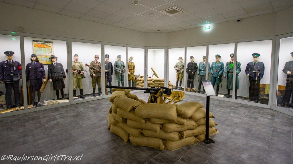 Uniform display with interactive long gun surrounded by sand bags