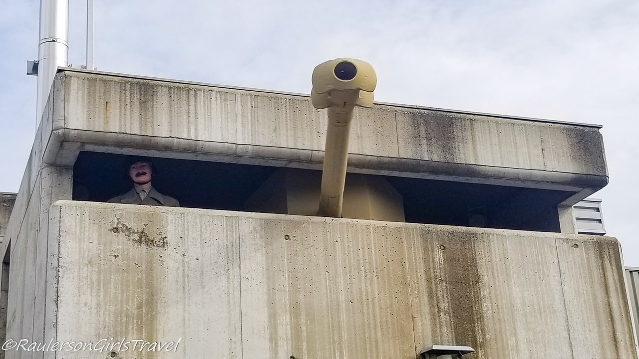 Rotating gun arm and soldier bunker display in the parking lot of MM Park France
