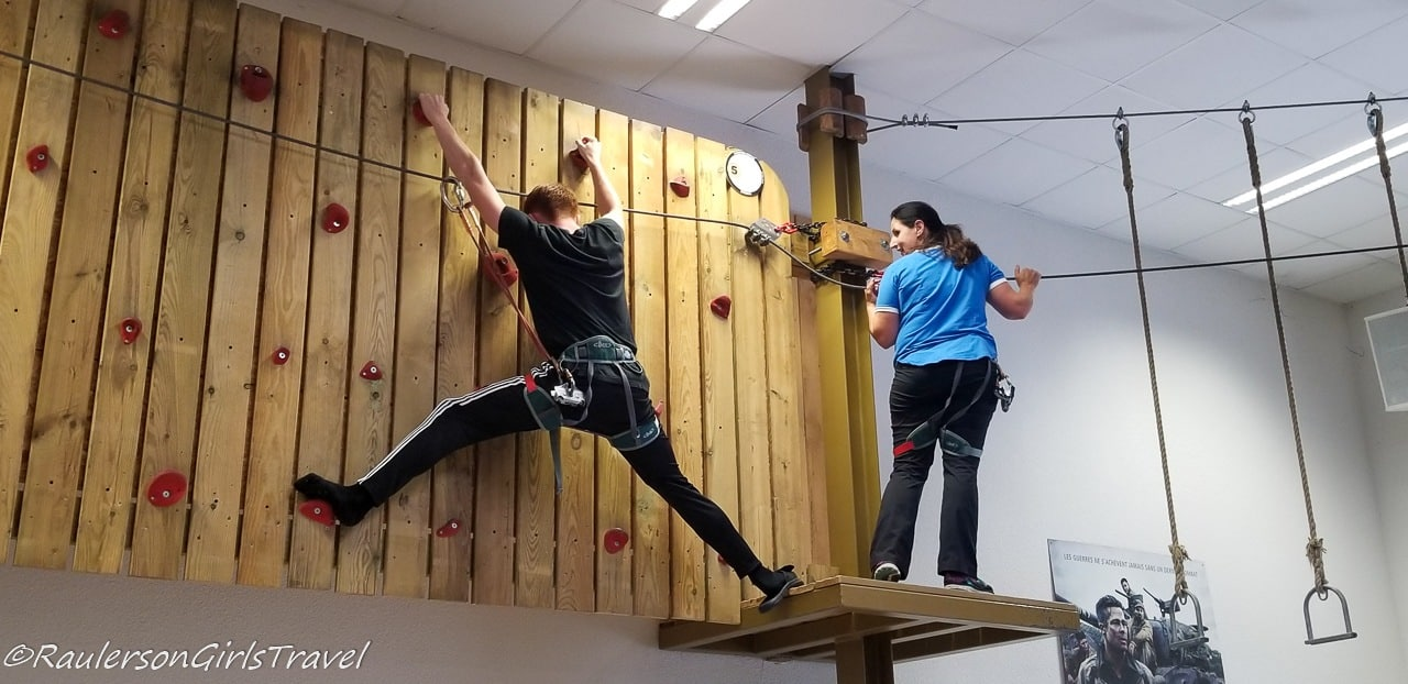 Conner showing Michelle how easy it is on the climbing wall
