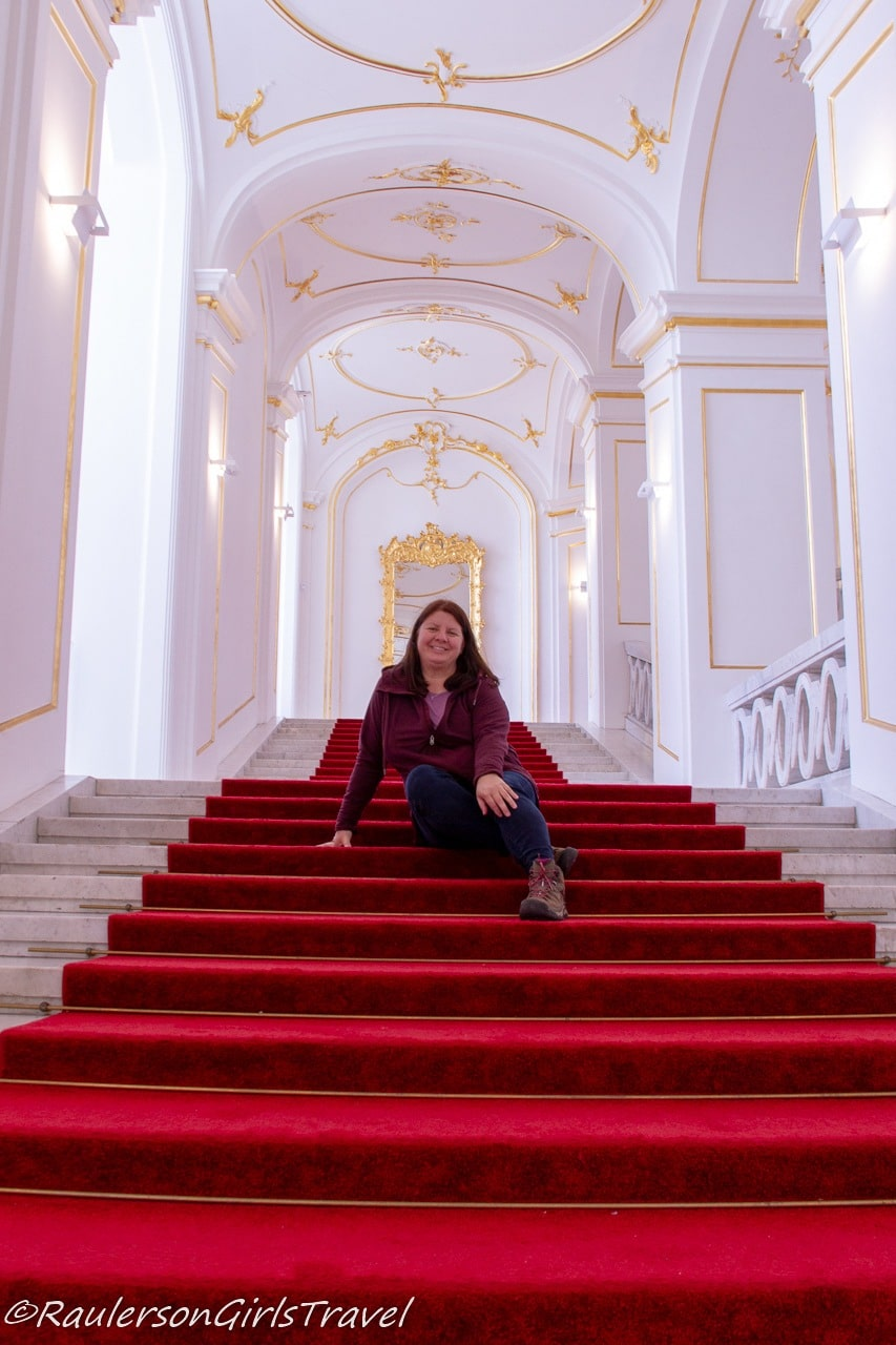 Heather sitting on the stairs in Bratislava Castle