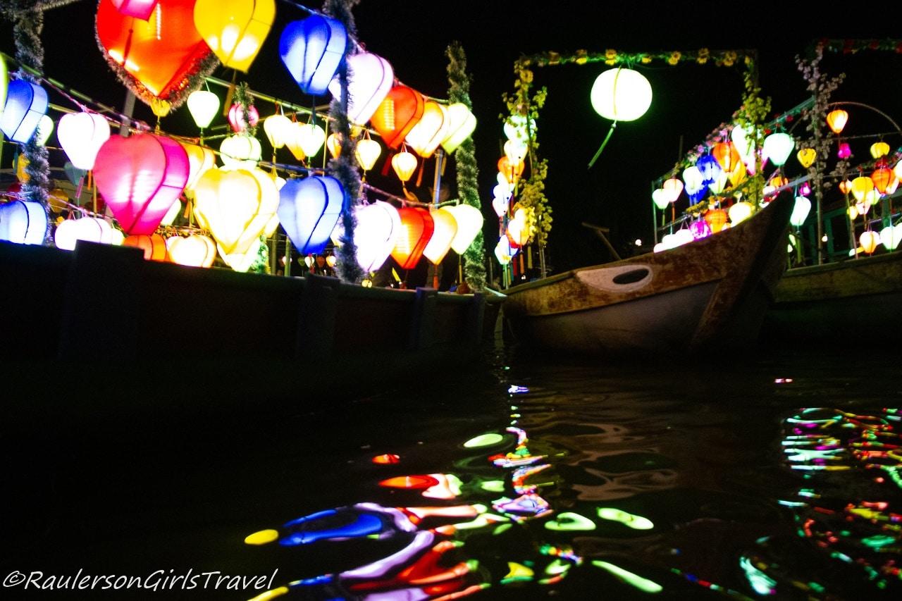 Lanterns lit on boats in Hoi An, Vietnam