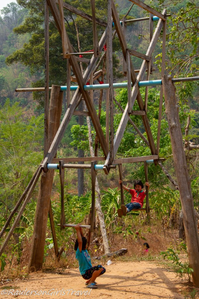 kids playing on a swing set in Thailand