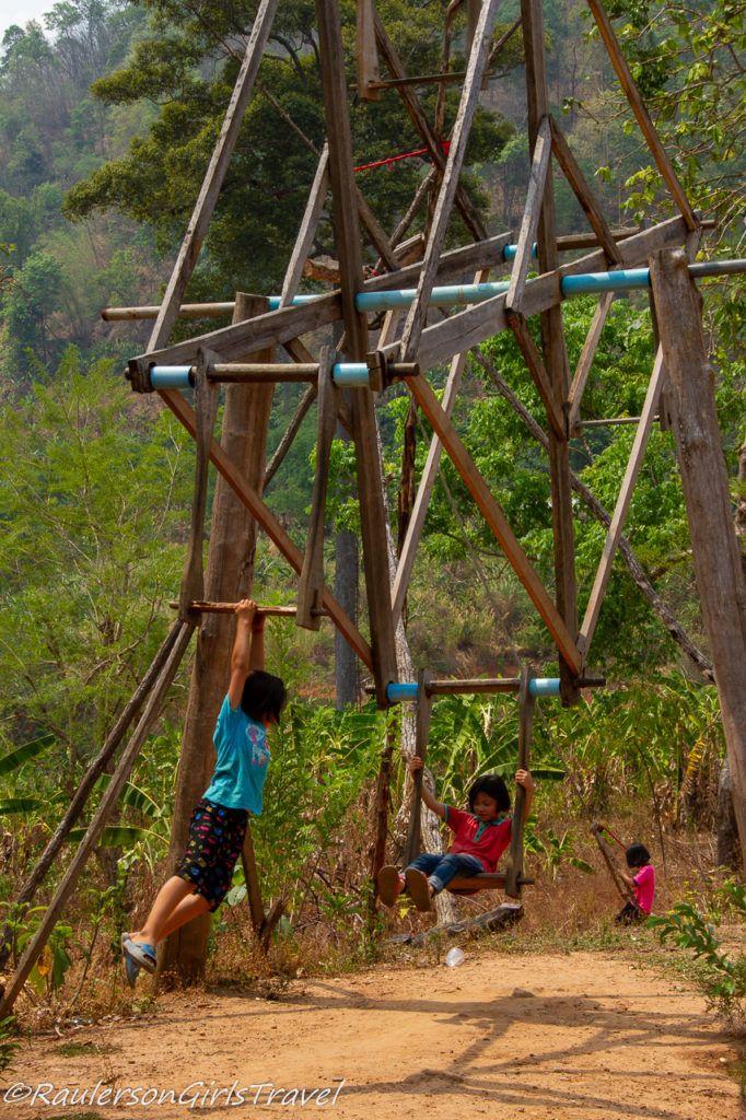kids swinging in Thailand