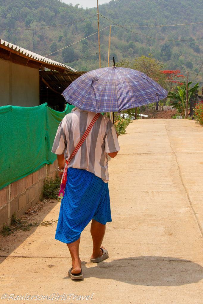 Man walking in Lisu Tribe Village