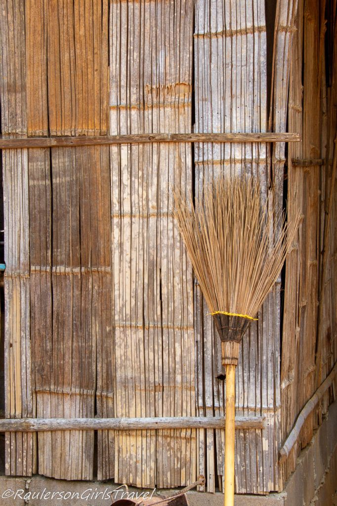 Broom leaning against a house