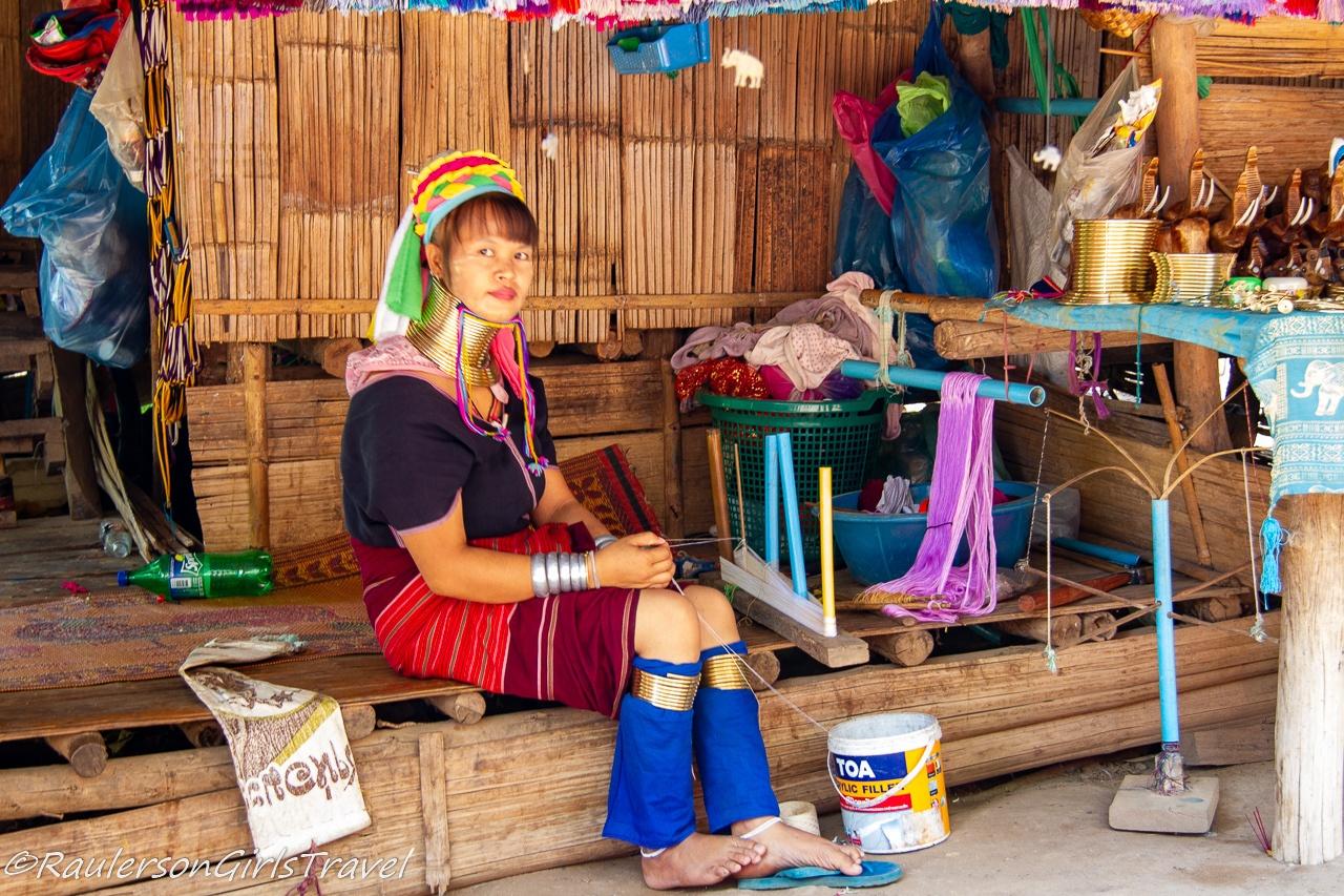Kayan woman making a scarf