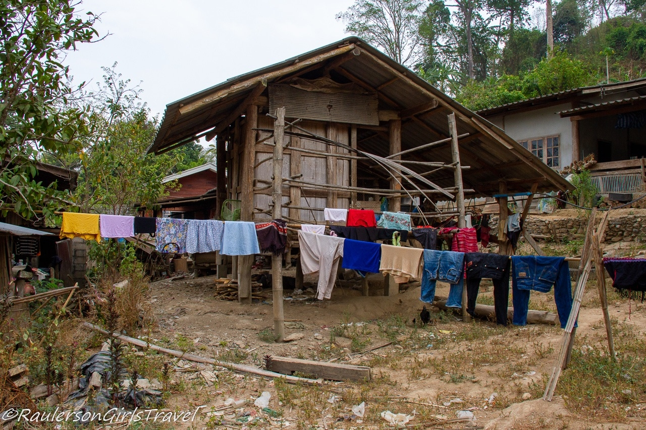 Home in Karen Tribe with clothes drying outside