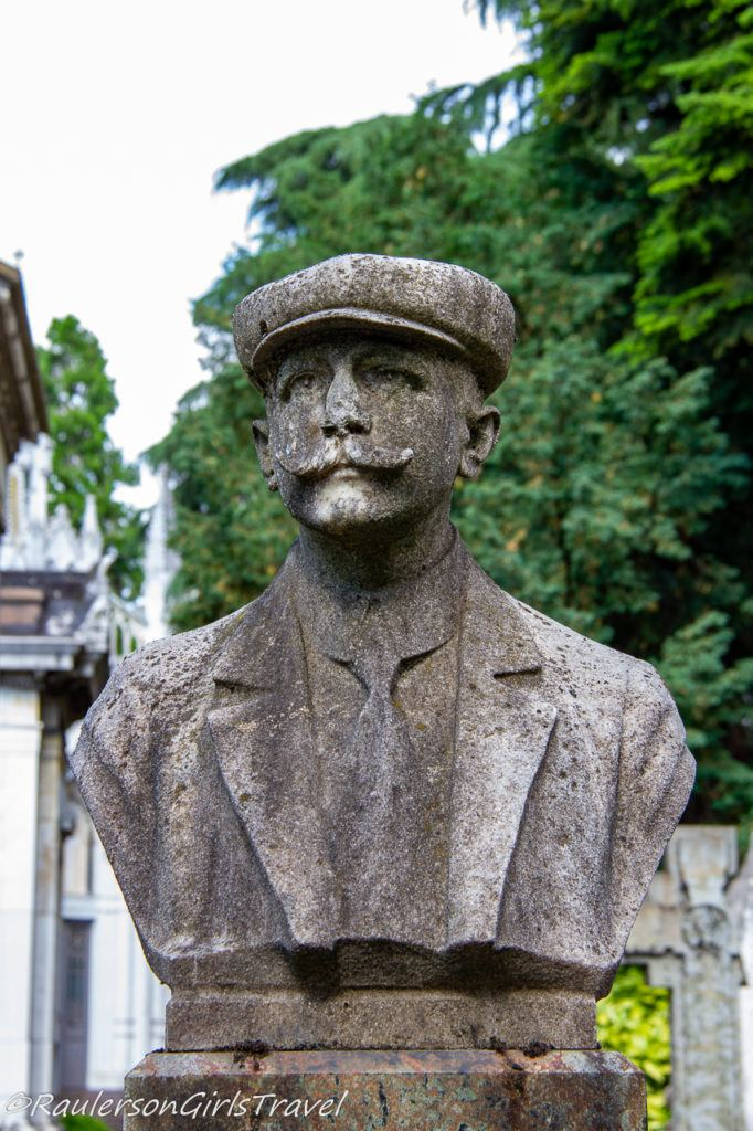 Man with cap and mustache bust