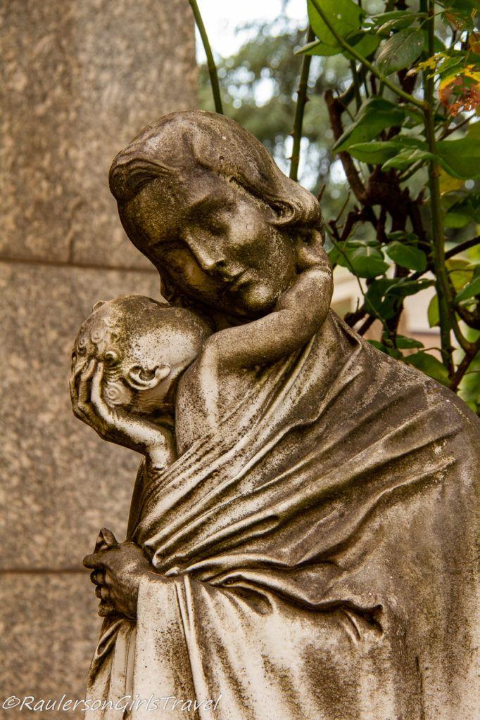 Mom cradling a child