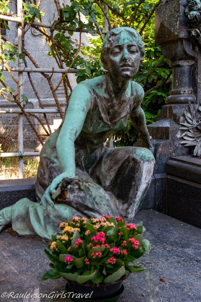 Lady kneeling for flowers