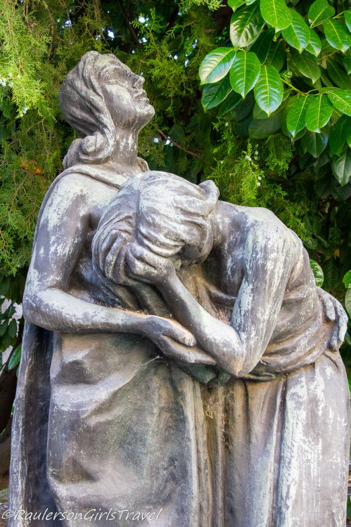 Lady holding a girl crying