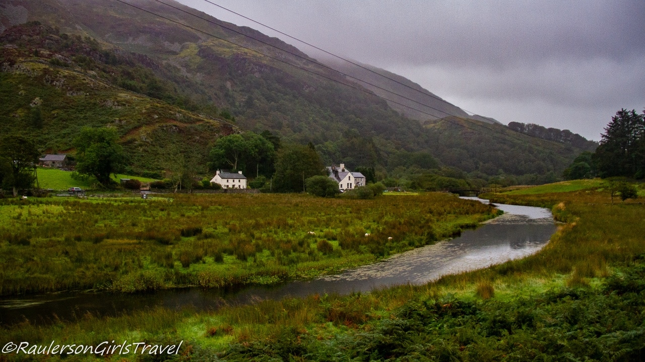 River going by houses in Snowdonia National Park