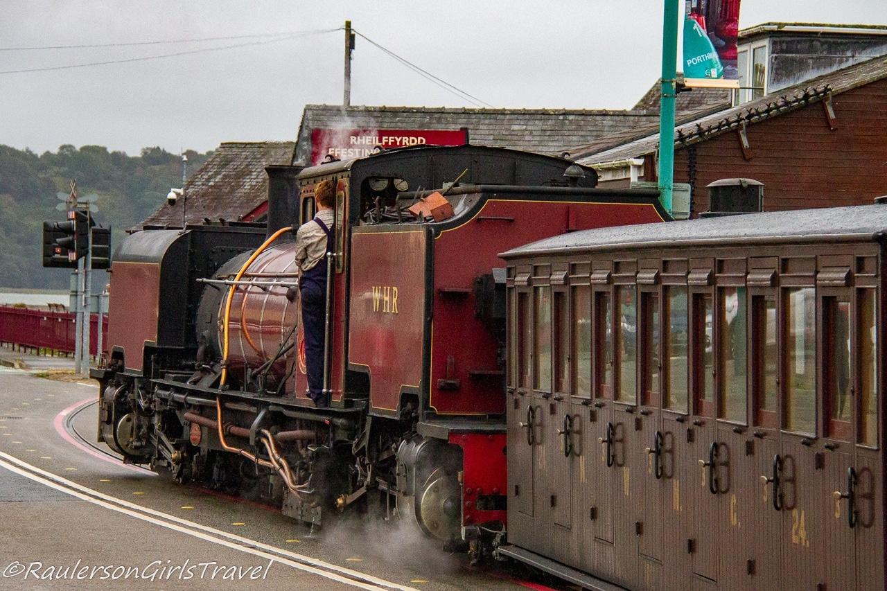 Train crossing the street in Porthmadog