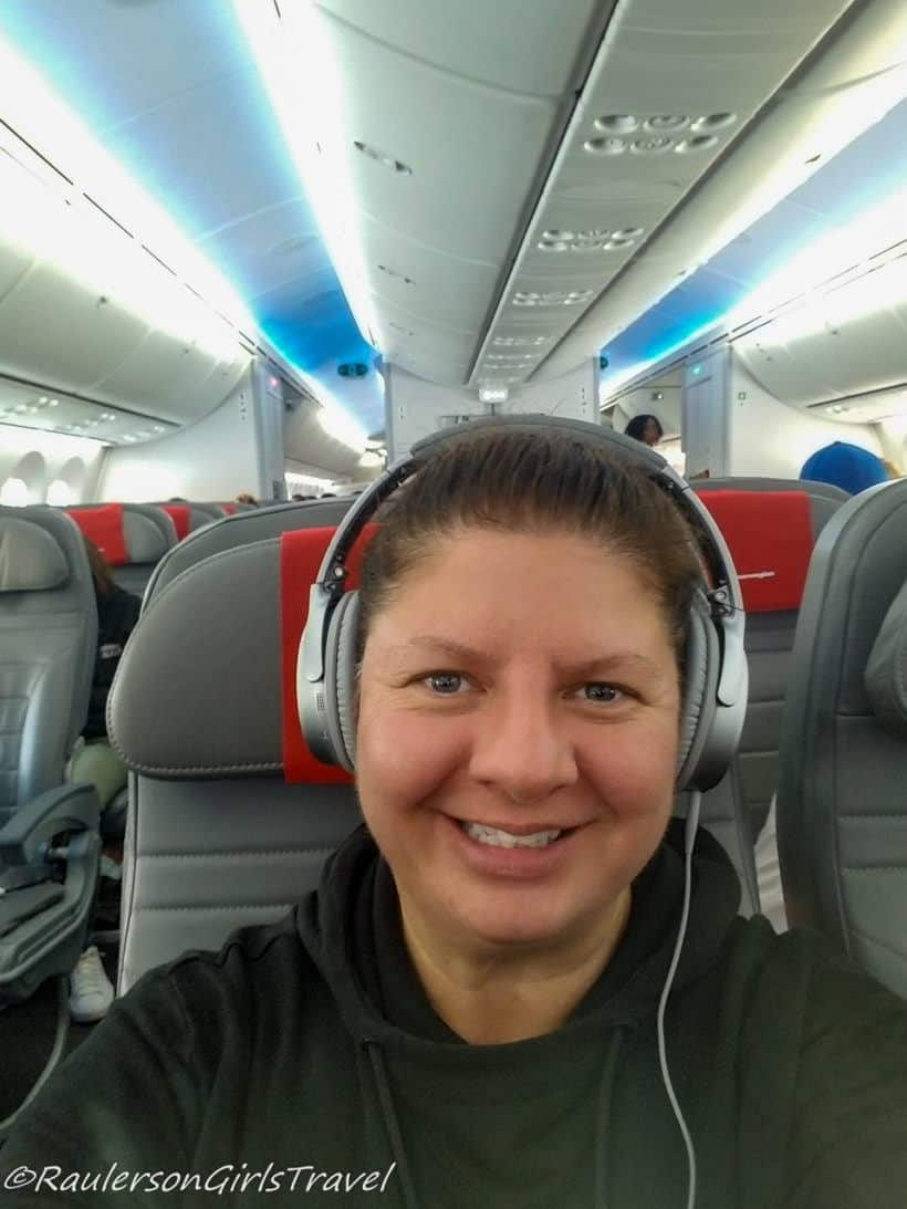 Heather traveling on a plane- Traveling Lessons