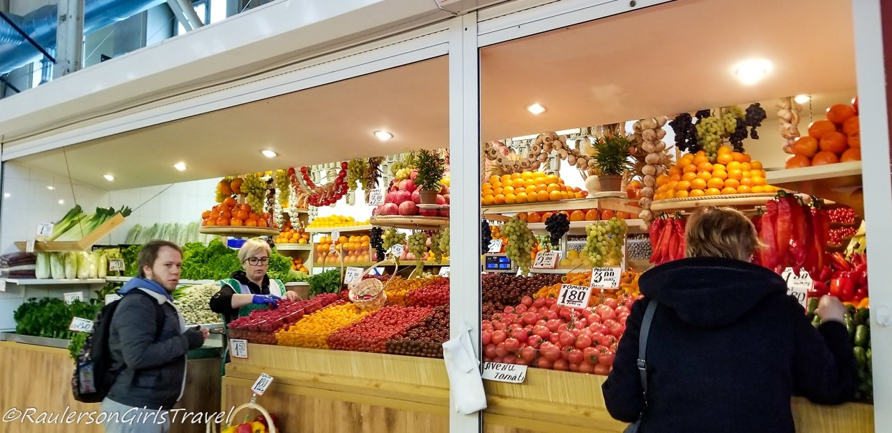 Buying fruits inside the Riga Central Market