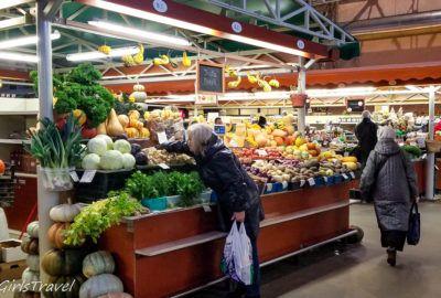 Shopping for vegetables inside the Riga Central Market