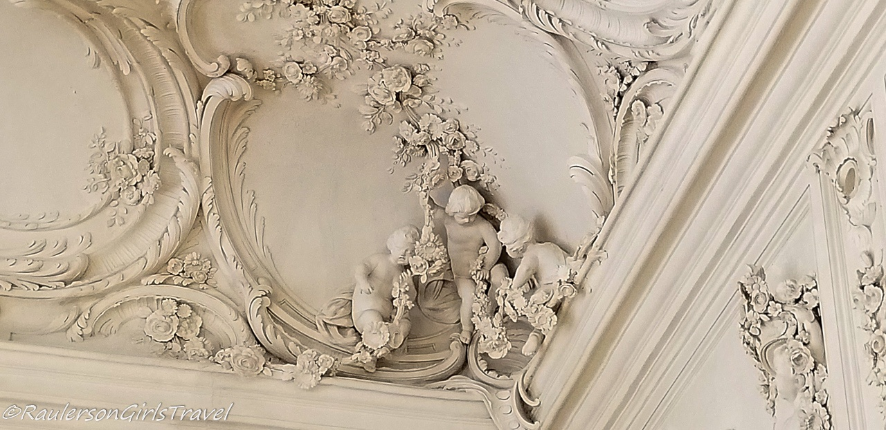 Ornate designs for each season in the Ballroom ceiling in the palace