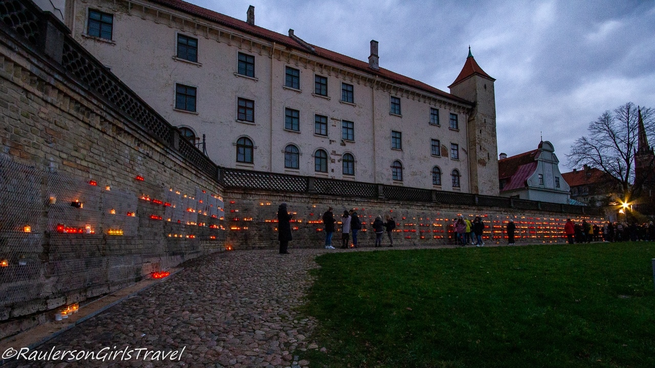 Candles lit on wall by Latvian Castle for fallen Latvian soldiers