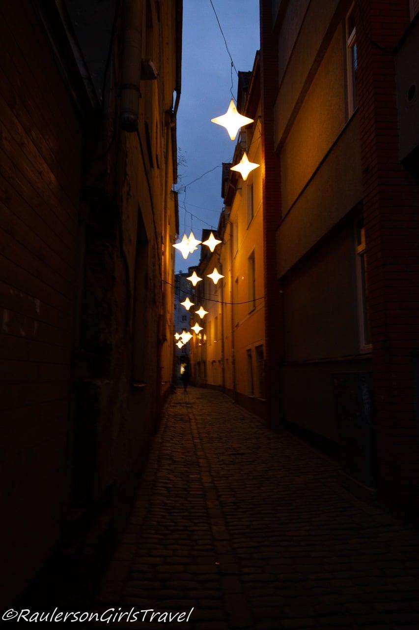 Stars lighting an alley in Riga