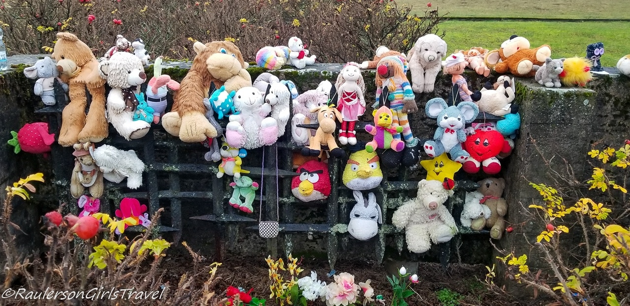 Stuffed animals at the marker for the Children's Barracks at Salaspils