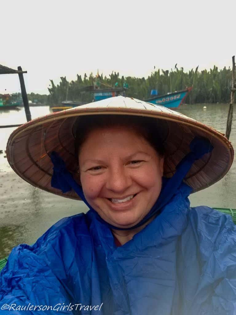 Heather on Thu Bồn River in the rain