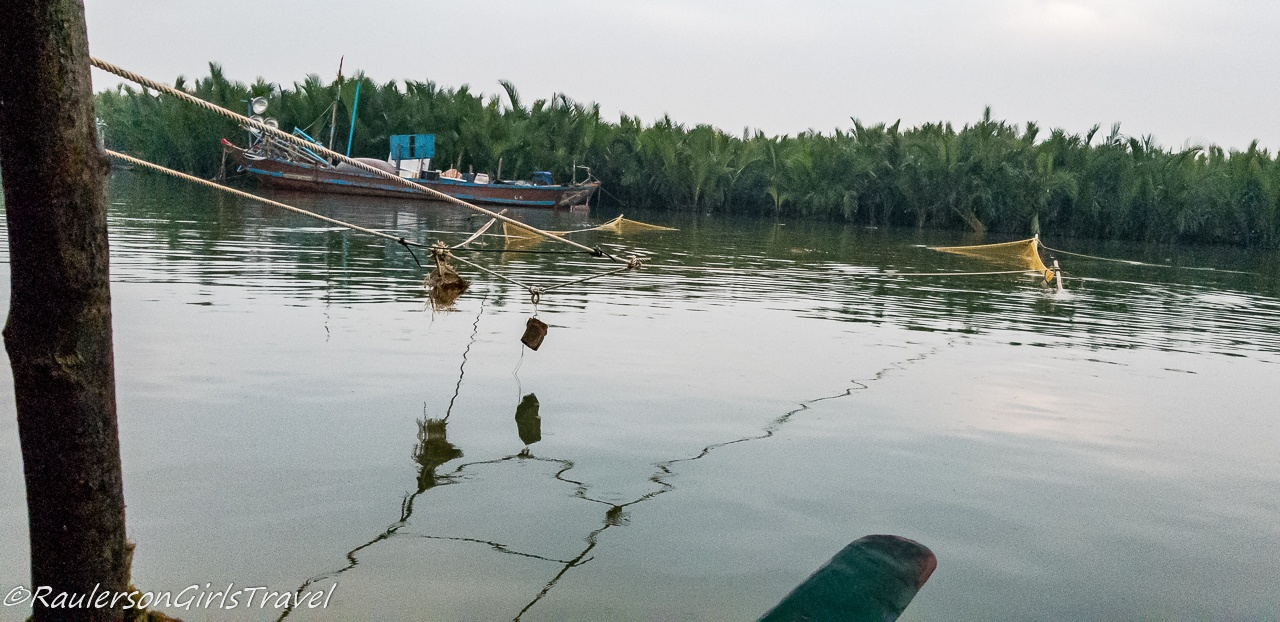 Fishing net in the water in the Thu Bồn River