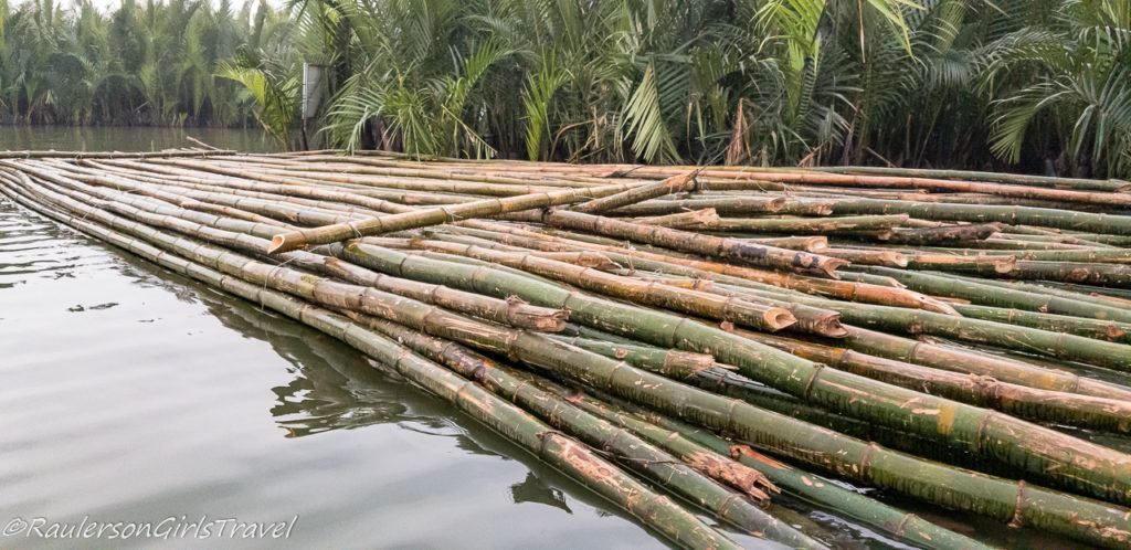 Bamboo sticks stacked in the river