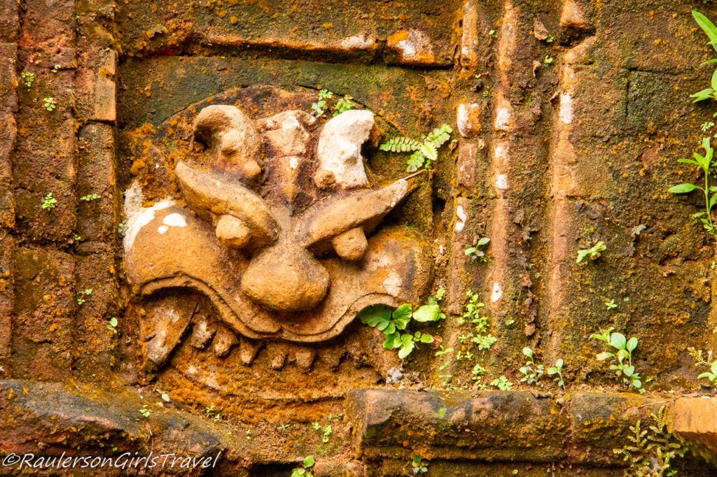 Face carved into temple wall