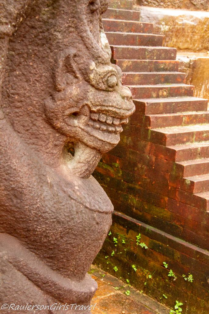 statue overlooking the stairs