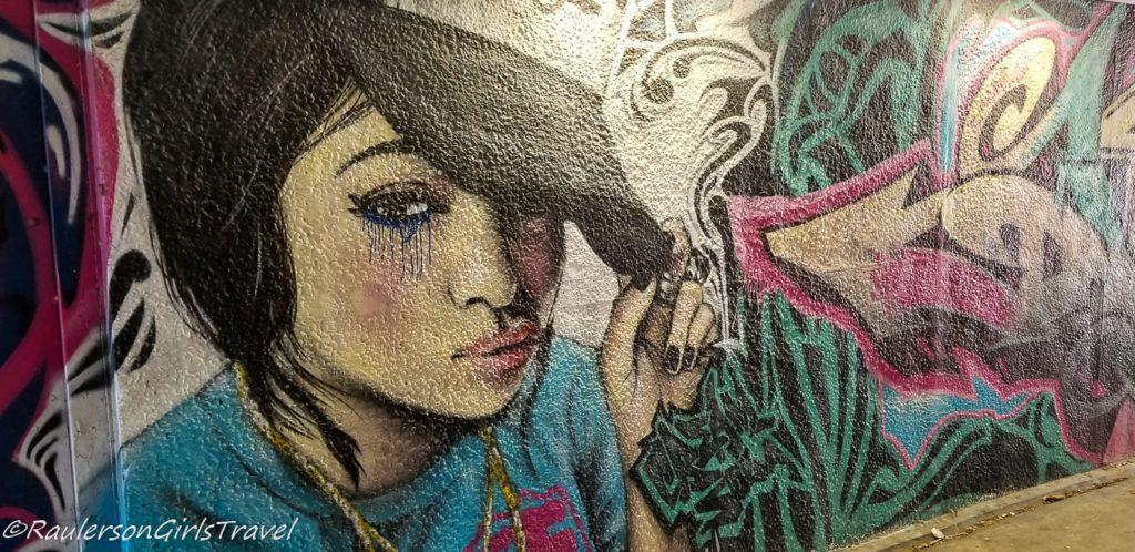 Girl with Ball Cap street art