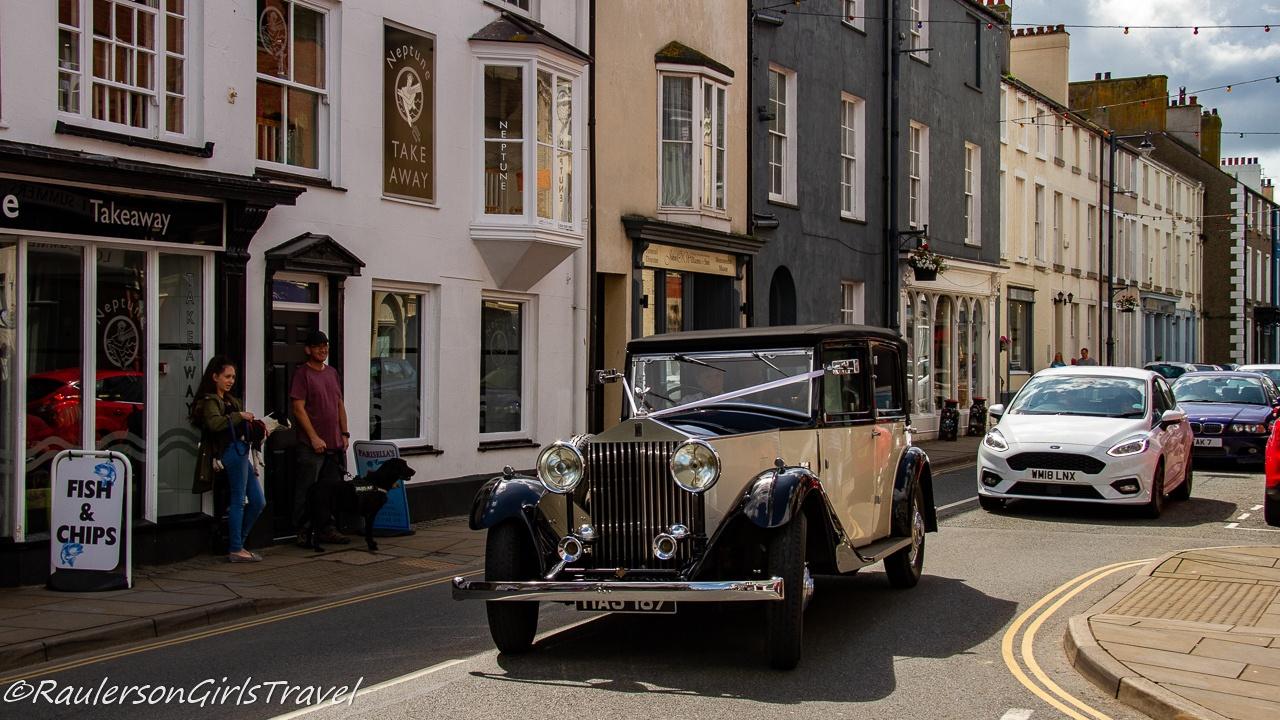 Vintage car driving through Beaumaris
