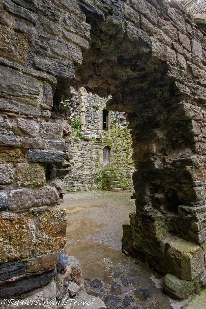 View through archway into a castle room