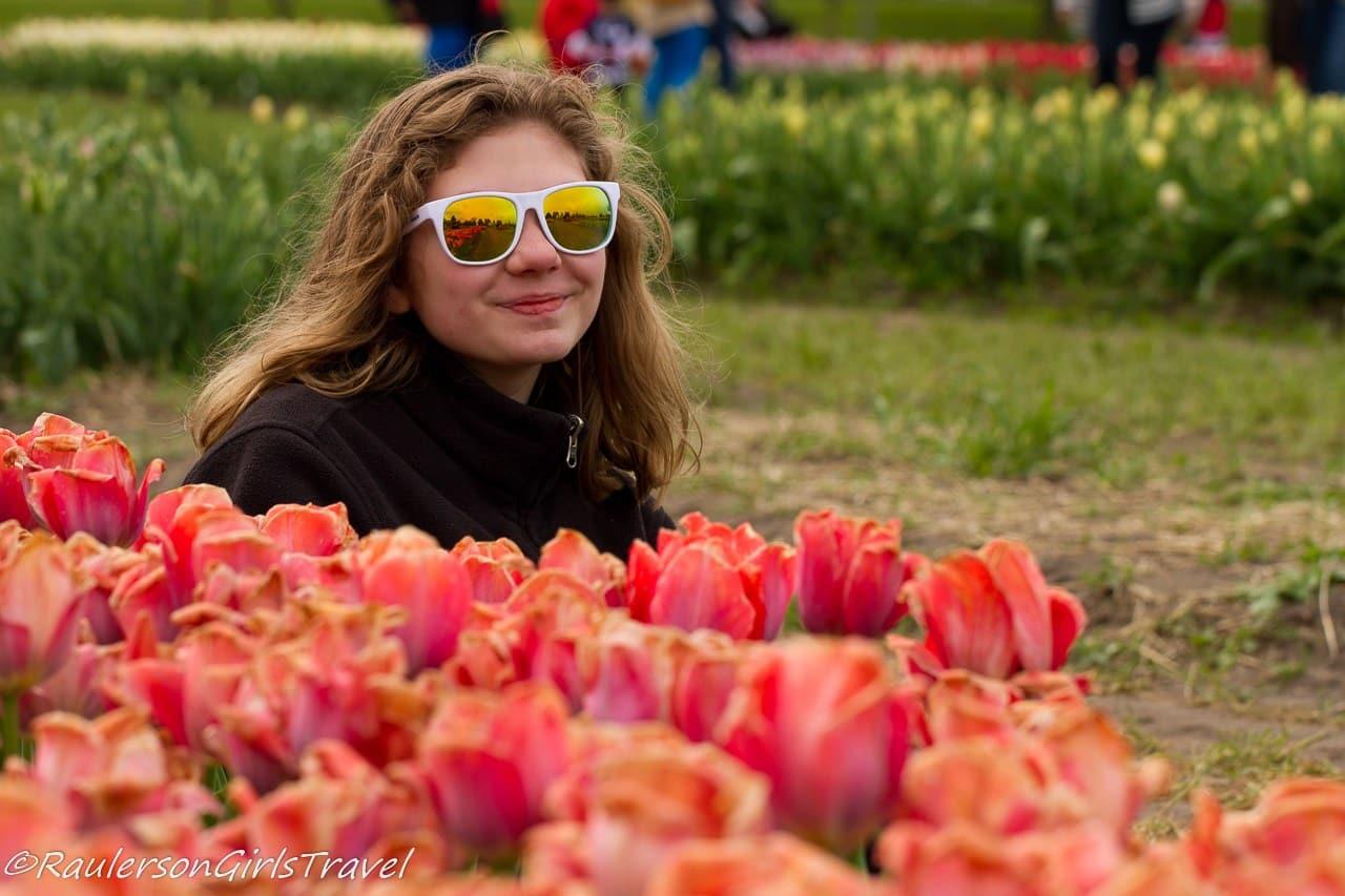 Madison posing with orange cream tulips