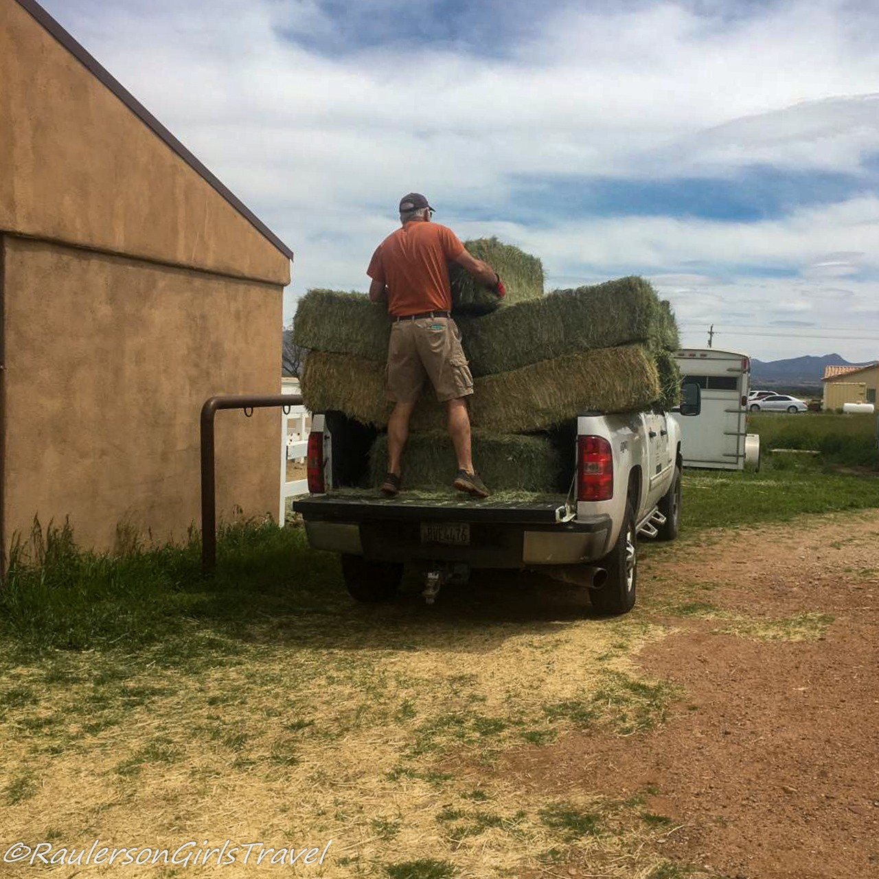 Picking up bales of hay for the horses